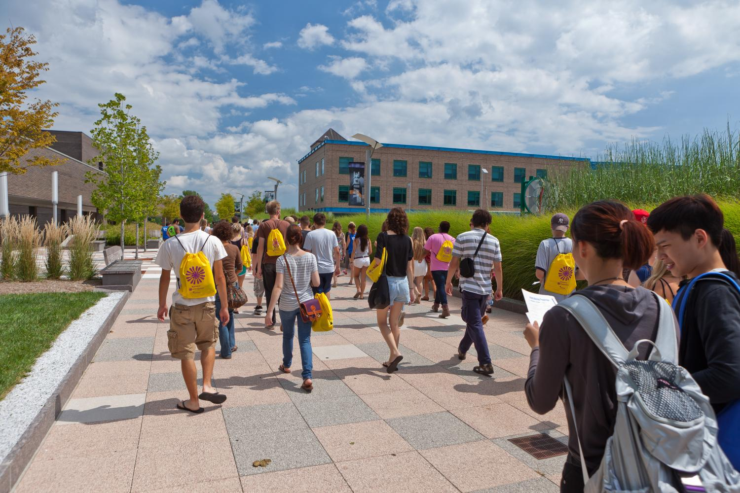 Walking+around+together%2C+new+college+students+take+a+tour+of+their+school%27s+campus.+Tours+and+orientations+help+students+get+ready+for+their+college+experience.