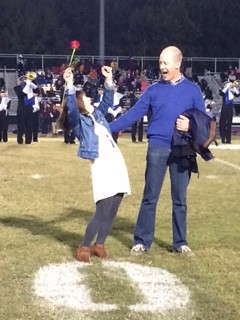 Pumping her fists in the air, Senior Maggie Leahy celebrates winning Homecoming Queen. This is the first year that a special needs student has been nominated for the coveted title at Millbrook.