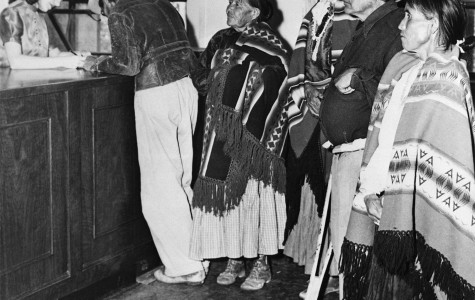 Waiting to register to vote, several Native Americans stand in line after the news of the Voting Rights Act passing reached them. Voting has always been a huge issue in the Native American community due in large part to the constant turmoil in the status of citizenship.