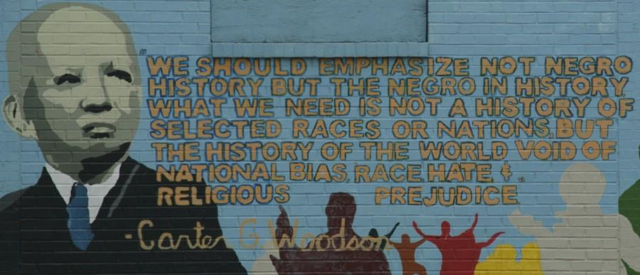 Near Woodson's former home in Washington, D.C., local artists painted a mural to remember the founder of Black History Month. Carter G. Woodson, the son of a slave, was one of the first scholars to study African American history.