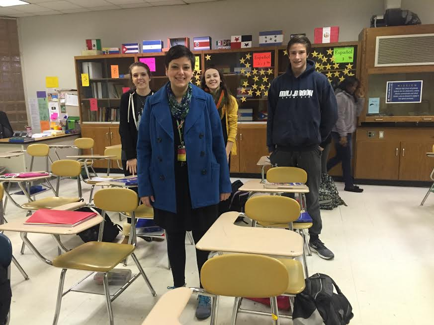 Gathered in her classroom, Ms. Van Wagnen poses with her first block students before school starts. Ms. Van Wagnen is often at school early for tutoring.