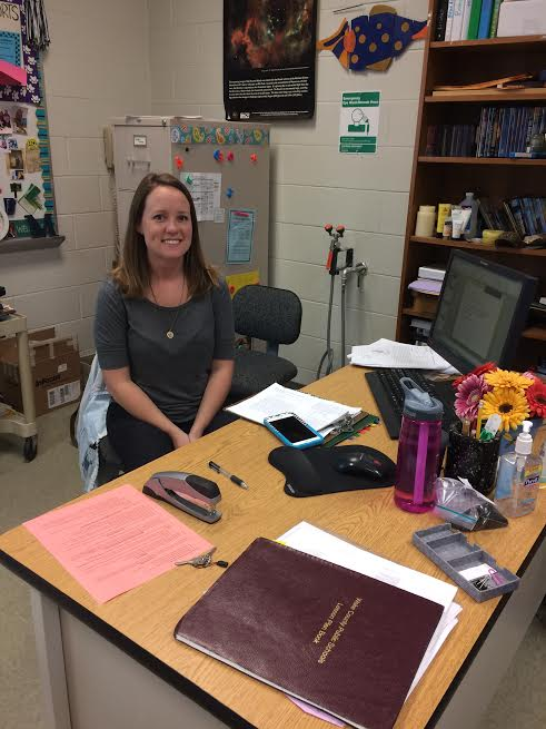 Sitting at her desk, Ms. Edwards takes a break from planning for her three science courses. Ms. Edwards has been teaching at Millbrook since 2002.