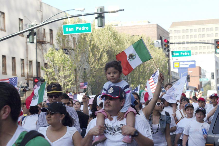 Marching in the streets of Northern California's largest city, San Jose, Mexican immigrants wave flags as they celebrate their heritage and protest for more rights. Research shows that 37% of employed immigrants in the United States with at least a college degree are overqualified for their jobs.
