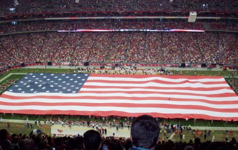Stretched across a field, the iconic American flag is known for its patriotic symbolism. It is now being used as a platform for protest for many athletes in the NFL.