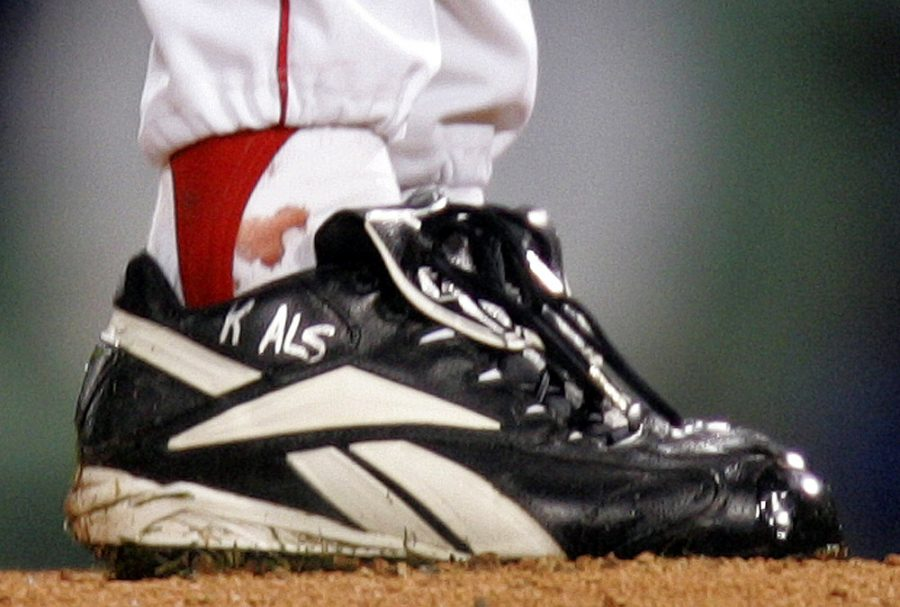 The+torn+tendon+sheath+in+Curt+Schilling%27s+right+ankle+bleeds+through+his+sock+during+game+6.+Schillings+pitched+through+this+and+had+one+of+the+most+memorable+games+in+postseason+history.