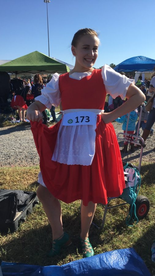Posing+for+a+quick+picture+before+changing+into+a+different+costume+for+her+next+dance%2C+Waverly+Noble+loves+her+Jig+dress.+Waverly+placed+fourth+for+her+Earl+of+Erroll+dance+at+her+competition+in+Richmond%2C+Virginia.