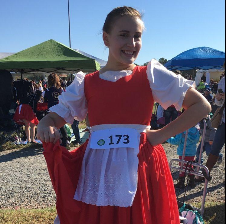 Posing for a quick picture before changing into a different costume for her next dance, Waverly Noble loves her Jig dress. Waverly placed fourth for her Earl of Erroll dance at her competition in Richmond, Virginia.