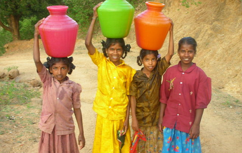 Carrying water for their families instead of being in school, these young girls are on the path to be impoverished their whole life. We must end the cycle of poverty by bridging the gender gap.