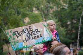 Protesting at Standing Rock, this little girl holds up sign in support of the Sioux tribe. People of all races, genders, and different Native American tribes have gathered to protest the pipeline.