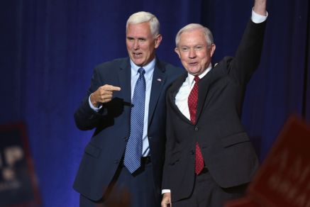 Standing side-by-side, Cabinet members Mike Pence and Jeff Sessions address a crowd at an immigration policy speech in Phoenix, AZ. Jeff Sessions will preside over the Department of Justice as Attorney General in the U.S. Cabinet.