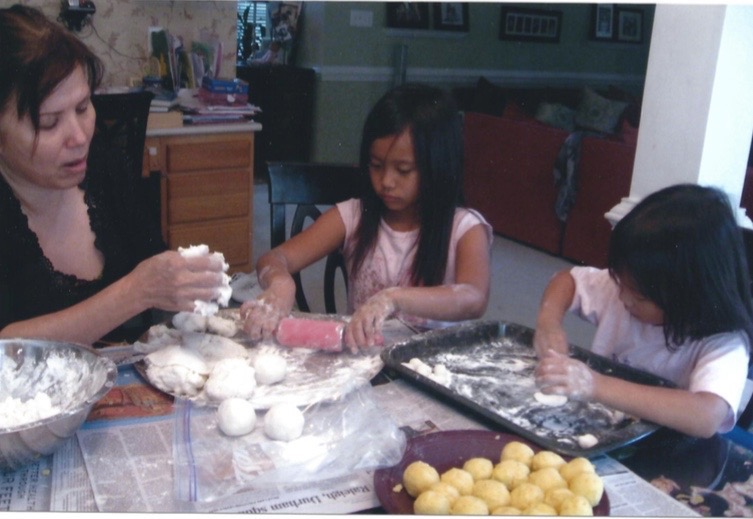 Making dough dumplings for a Vietnamese dessert called che, Kim Nguyen (left) enjoys teaching her grandaughters Mady Ignacio (middle) and Aly Ignacio (right) how to prepare Vietnamese dishes. Lunar New Year is a huge celebration for some and a household celebration for others but special nonetheless.