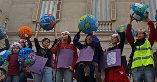Protesting in front of a public building, women in Barcelona, Spain show their support on International Women's Day.  This day is celebrated all over the world by men and women who believe in equality for both the genders.