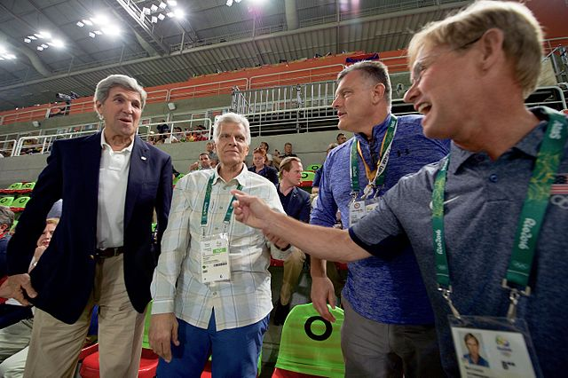 Conversing+with+fellow+Olympians+and+politician+John+Kerry%2C+Steve+Penny%2C+pictured+middle+right%2C+enjoys+his+last+Summer+Olympics+in+Rio+de+Janeiro.+Penny+resigned+as+President+and+CEO+of+USA+Gymnastics+on+March+9.%0A