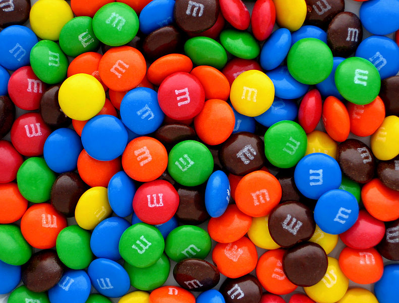 Pictured above, Mars' Original flavor M&Ms today come in six colors. Initially, there was not an orange or blue M&M, but over time, the public voted to add these colors.