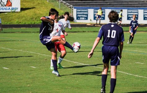 Warding off the defender, Ryan Rebne passes the ball to a teammate. Playin soccer is one of many things Ryan enjoys doing here at Millbrook.