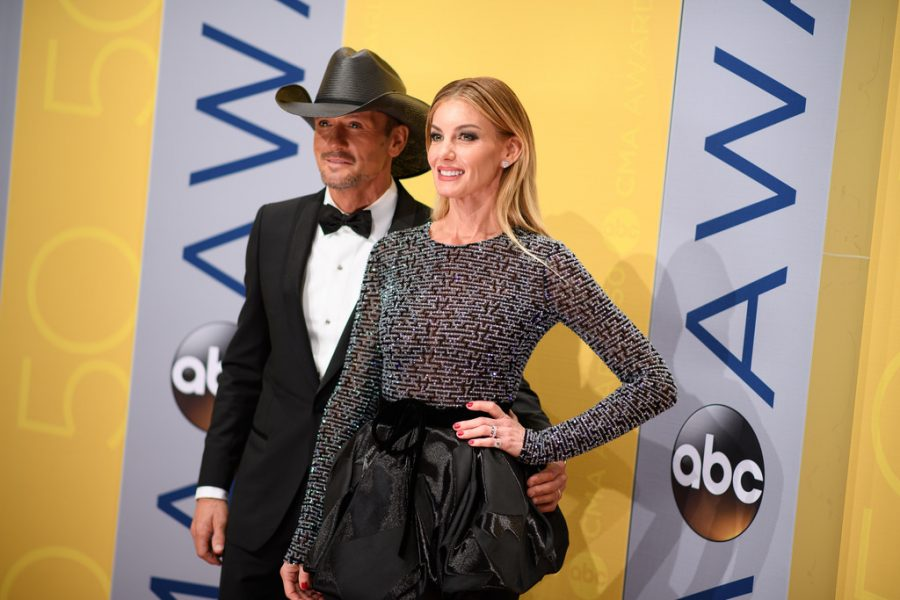 """Posing for pictures on the red carpet, Tim McGraw and his wife Faith Hill head to the arena. The married couple greeted the hosts on stage and performed their new song """"Rest of Our Lives"""" at the 51st CMA Awards."""