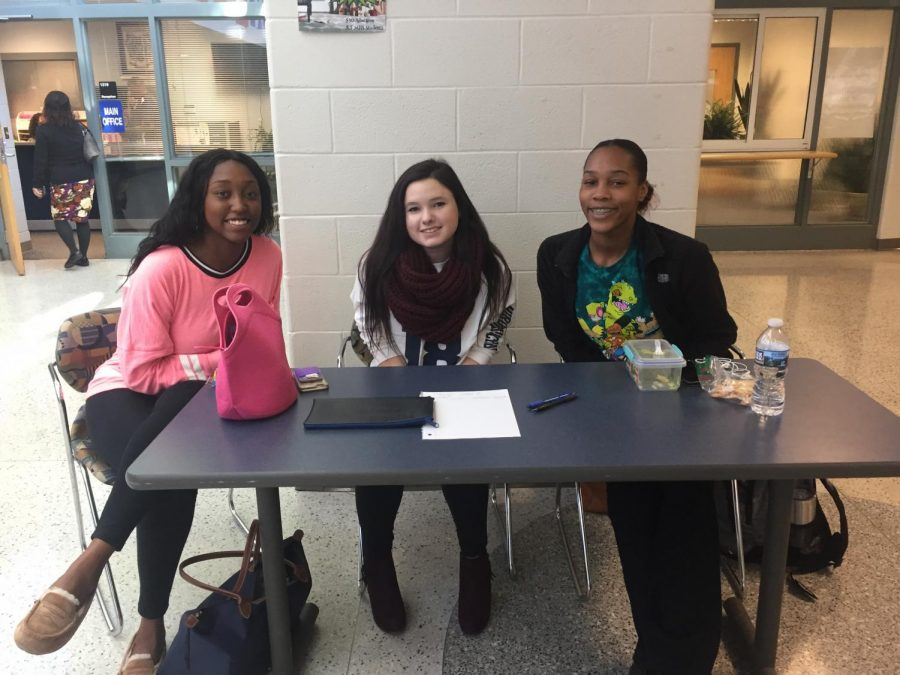 To promote holiday spirit, NHSDA members Essence Ferguson (vice-president), Christina Bailey, and Damaris Jackson are selling candy canes during lunch. The funds from the candy canes will be donated to help the special needs take dance classes.