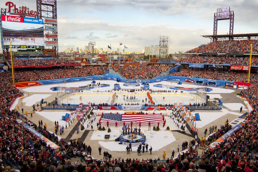 Standing for the National Anthems, the New York Rangers  get ready to play in the 2012 Winter Classic. Six  years later, the Rangers will be participating once again, this time playing the Buffalo Sabres.