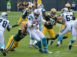 Battling against the Green Bay Packers in a intense game of football, the Carolina Panthers try  to score points to win a tough game. The Carolina Panthers, currently owned by Jerry Richardson, will be up for sale at the end of the season.