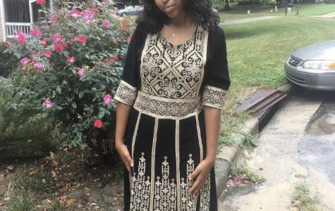 Embracing her Muslim-Moroccan heritage, Yousra dresses in an abaya to celebrate Eid-al-adha. Yousra takes pride in her faith and culture and contributes to the cultural diversity of Millbrook.