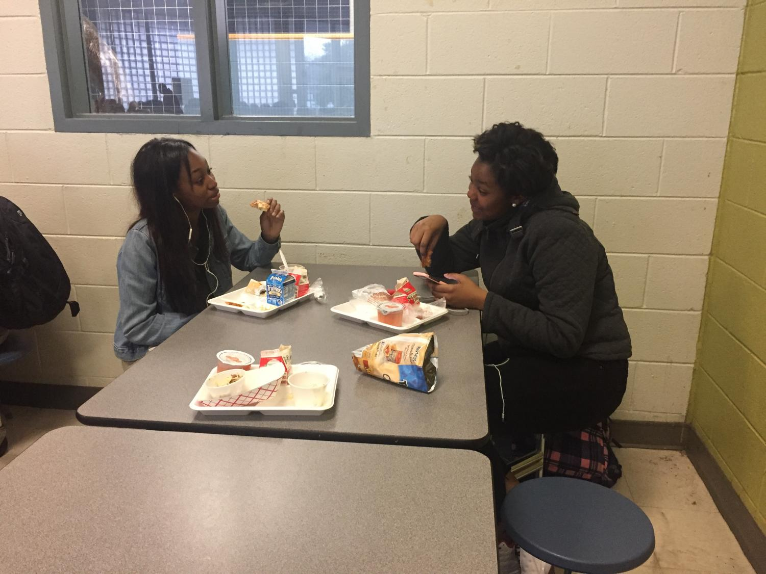 Eating nutritional lunches bought at school, Millbrook student Cayla Finch enjoys her break from classes. During the long holiday breaks and weekends there is no other way for students to get meals provided by the school.