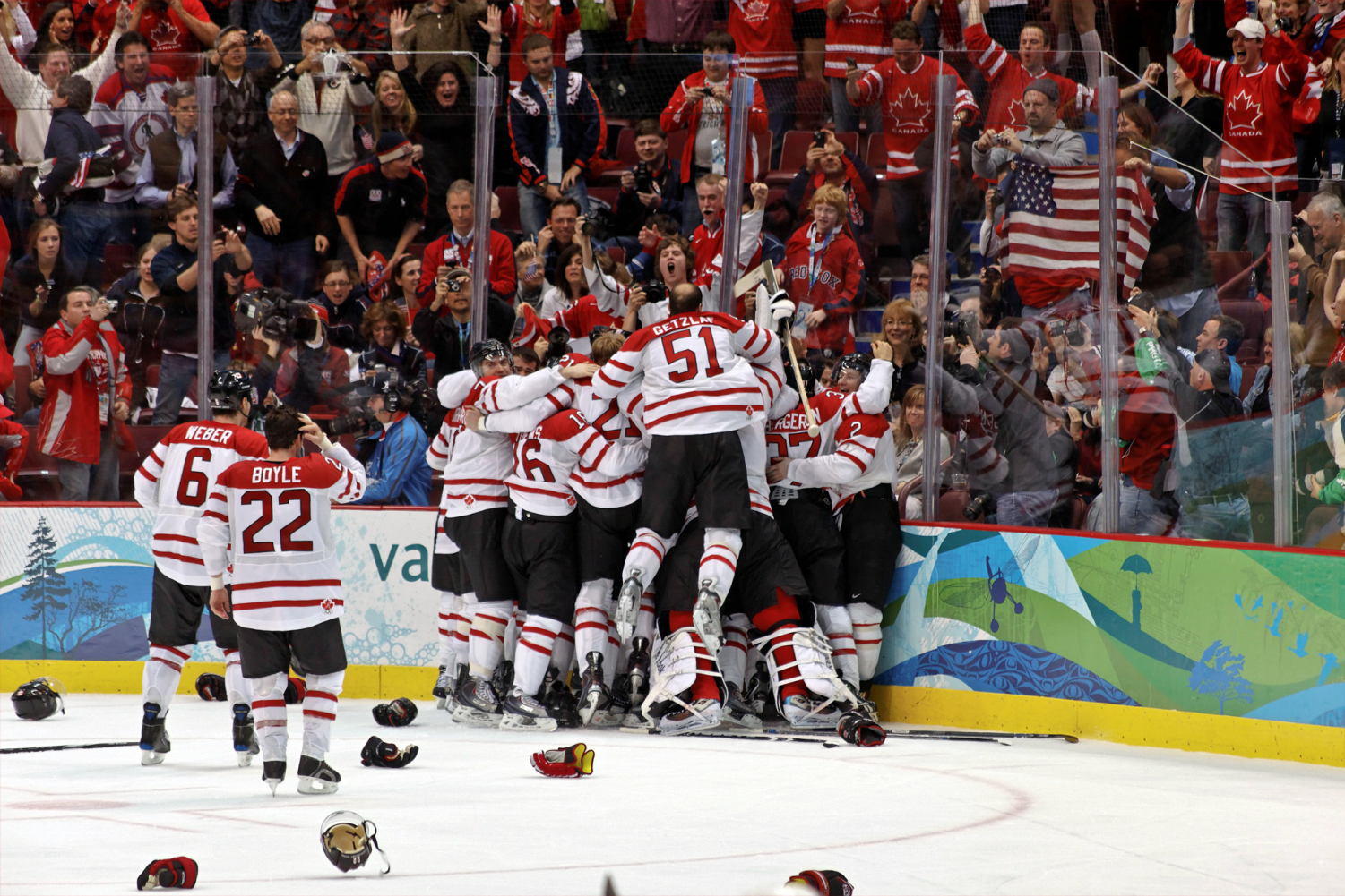 Celebrating after scoring the golden goal in the Vancouver Winter Olympics, Team Canada dog piles on top of captain Sidney Crosby. This year that same result can not be expected, as the team's best players will not be participating.