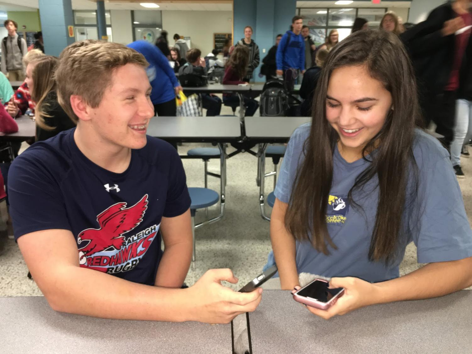 Enjoying each others company, Elizabeth Iager and AJ Kurke try to hold a conversation with each other without being distracted by their phones.