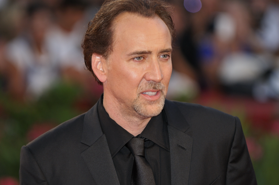 At an awards show, actor Nicolas Cage poses for a picture. Is it possible he could actually be a part of the undead?