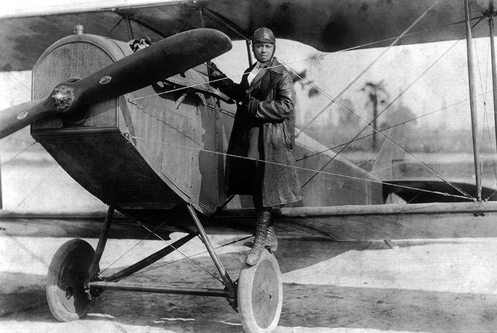 Preparing to take flight, pilot Bessie Coleman is about to climb into the pilot's seat. As the first Black American female pilot, Bessie was an inspiration for many women of color.