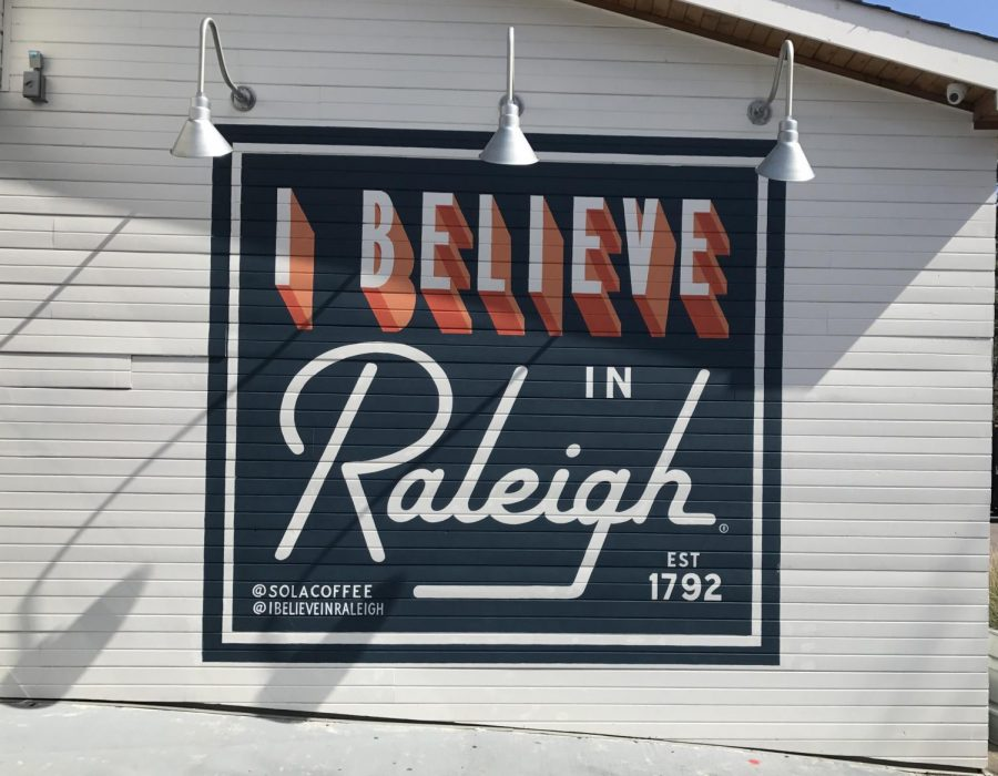 Representing+the+I+Believe+in+Raleigh+movement%2C+the+mural+is+painted+across+the+back+of+the+picturesque+Sola+Coffee+Caf%C3%A9.+Sola+is+the+perfect+place+for+anyone+looking+for+a+cozy%2C+laid-back+dining+experience+and+a+taste+of+some+of+the+best+food+in+Raleigh.