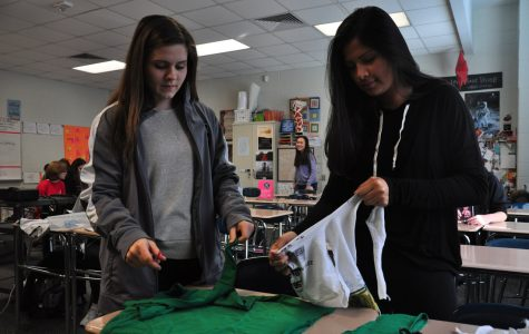 Working hard, club secretary Sara Vandersip and club service committee member  Kaylee Zuniga make dog toys out of old t-shirts to donate to the SPCA. The Key Club is a service oriented club focused to giving back to the community through different service projects.
