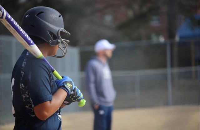 Looking off into the distance, Juliana Martinez prepares to hit a home run. Juliana is one of the returning softball members expecting a conference championship this year.