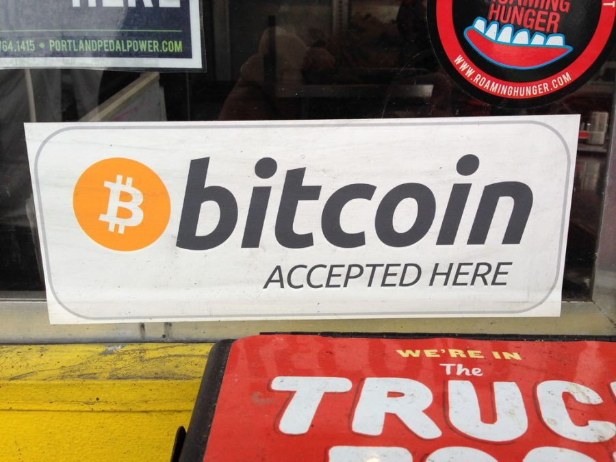 Posted in the window of a shop, this sign shows that the store takes bitcoin currency as pay. Bitcoin has been all the rage due to security and the potential to gain more money than investors begin with.