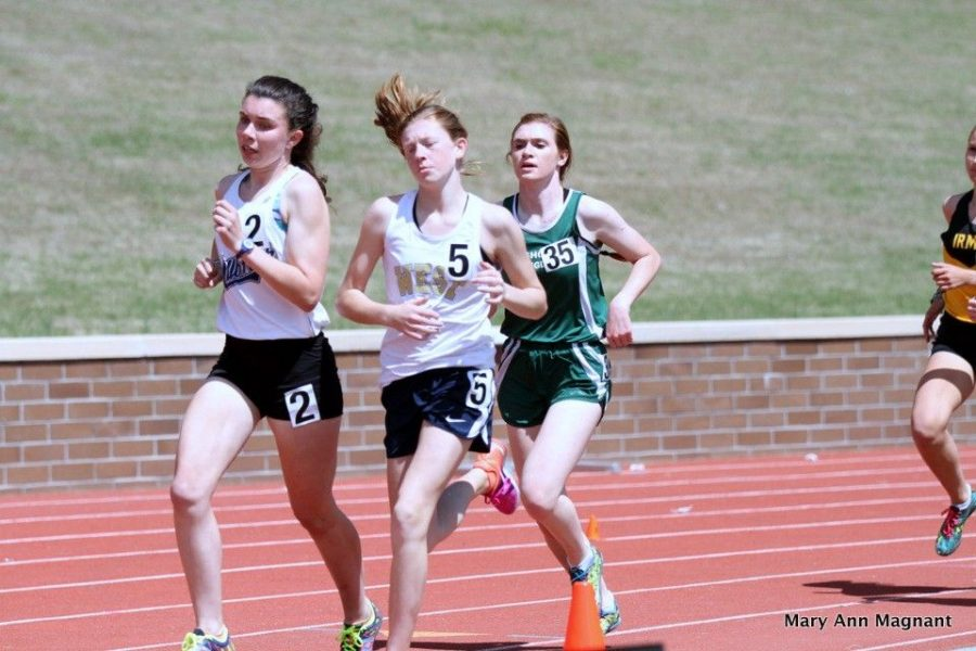 Leading the way in the Bojangles Invitational in Columbia, South Carolina, Sammy Storey, 2, speeds past in the mile during track season. This is just one of many things Sammy does here at Millbrook.