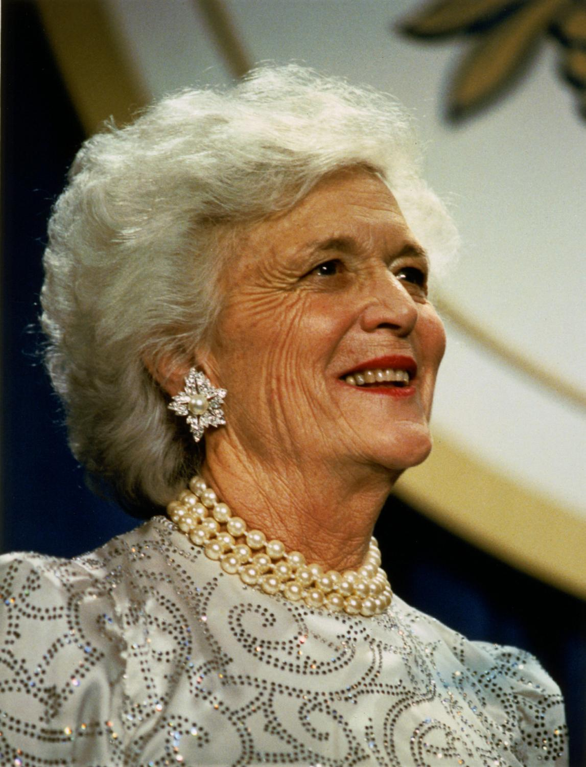 "Smiling into the distance with her signature pearls visible, Barbara Bush is seen as ""everyone's grandmother."" Mrs. Bush passed away on Tuesday, April 17."