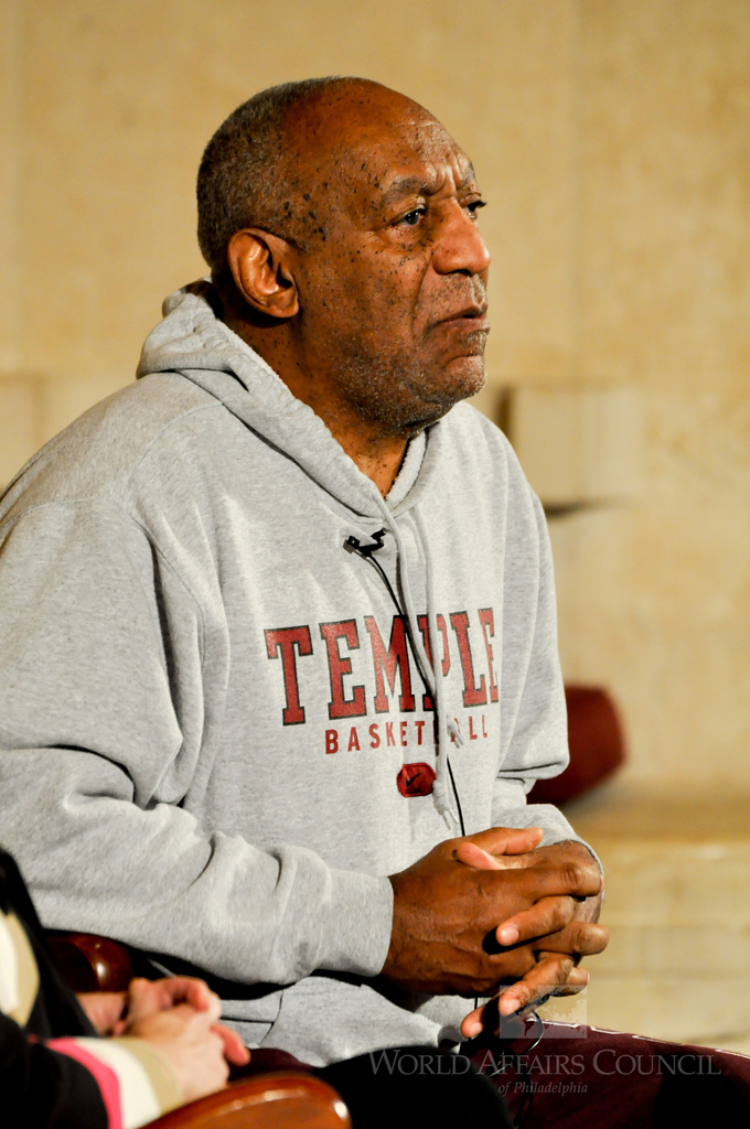 Staring into the crowd, Bill Cosby prepares to give a speech at the World Affairs Council. The once revered TV star has been found guilty of all three counts of aggravated indecent assault.