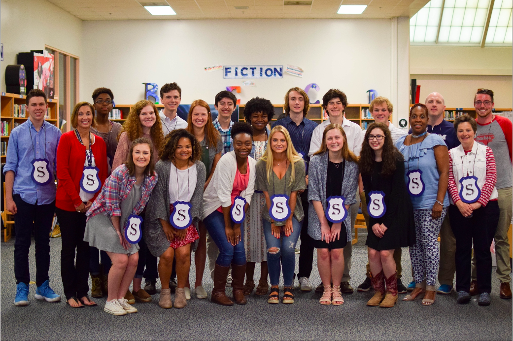 Showing their Millbrook pride, the 2018 Service Club inductees enjoy their reception with one another. At this year's assembly twenty one new members were inducted into Service club for their outstanding involvement in the Millbrook community.
