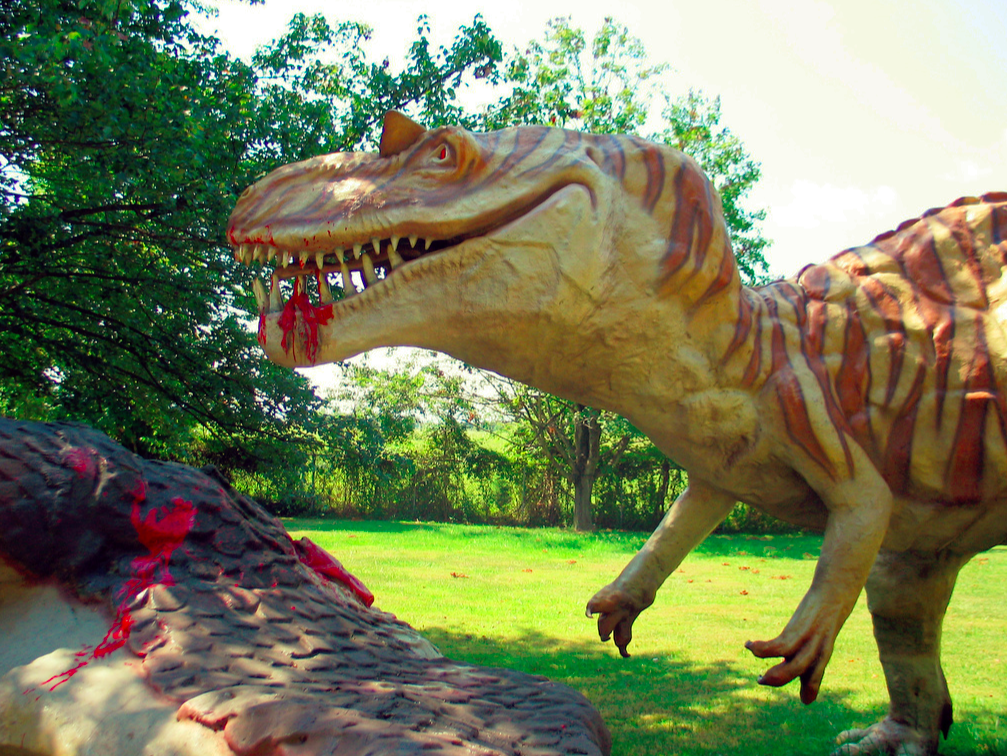 Gushing blood from the mouth, this fiberglass T-Rex chomps up his dinner. Thanks to the elevated prom budget, student will see this exact dinosaur at this year's Mesozoic prom.