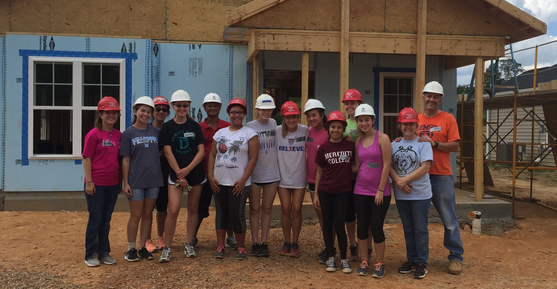 Celebrating a hard day of volunteering at Habitat for Humanity, members of IB programme line up for a picture. These students see their graduation in the near future, but continuously work hard to strive for future success.