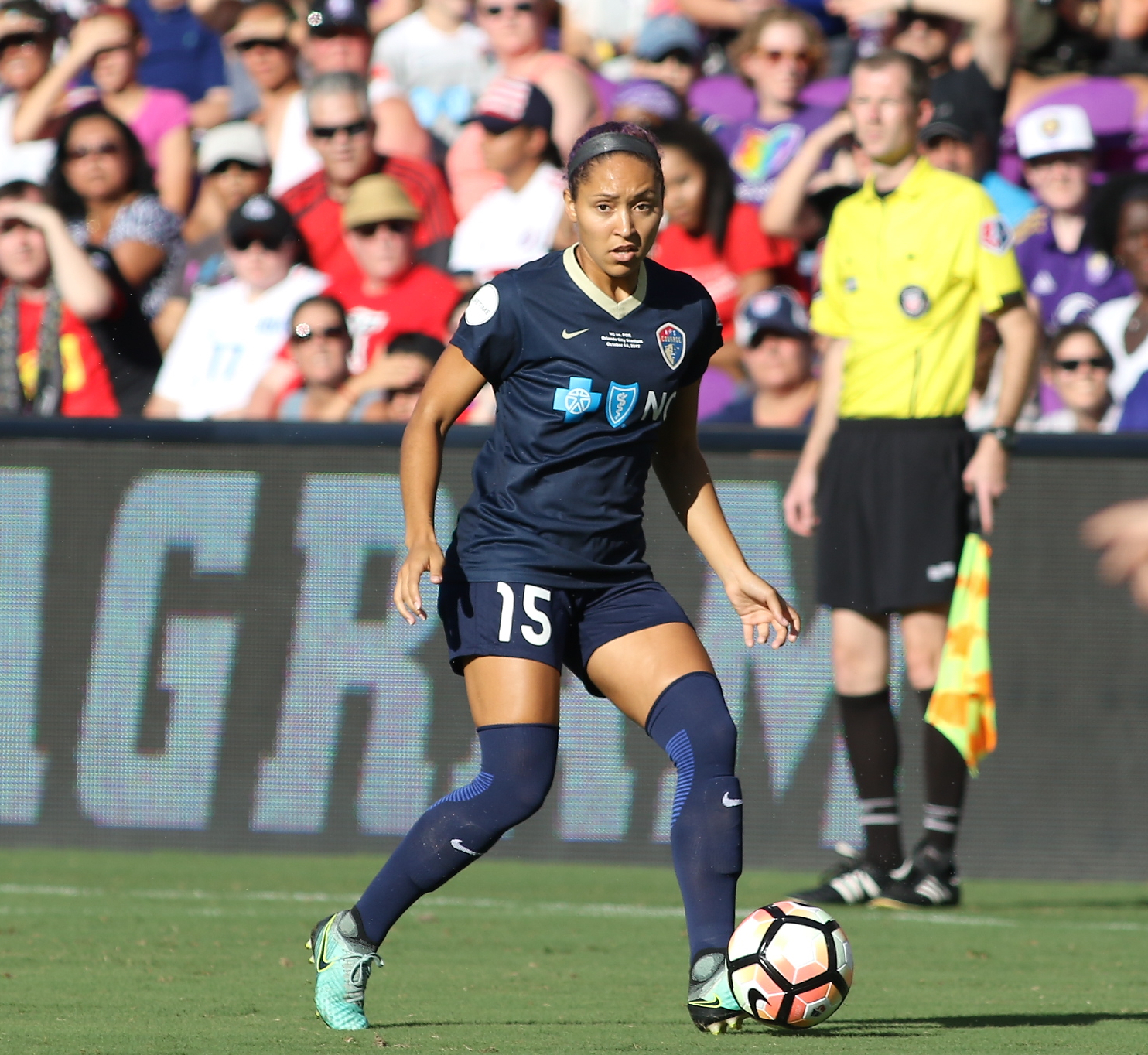Dribbling the ball up the field, number 15, Jaelene Hinkle, looks to score during a game. The NC Courage are currently on top of the standings in the NWSL, the most prestigious women's soccer  league in the U.S.