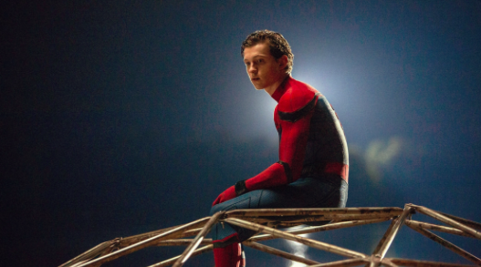 Sitting on a jungle gym, Peter Parker, also known as Spider-Man, awaits his next mission. Spider-Man: Homecoming, the most recent remakes in the Spider-Man franchise, was the fourth top grossing film of 2017, raking in over $880.1 million dollars, helping to perpetuate the nostalgic cinema movement even more.