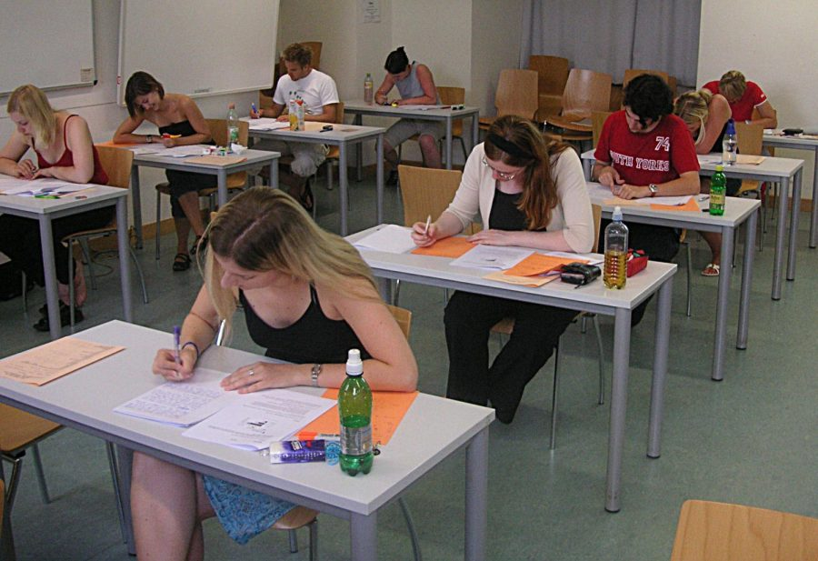 Working diligently at their desks, students complete test questions to demonstrate their knowledge in the class. Successful students may apply a series of specific strategies to help them to earn a favorable grade on the exam.