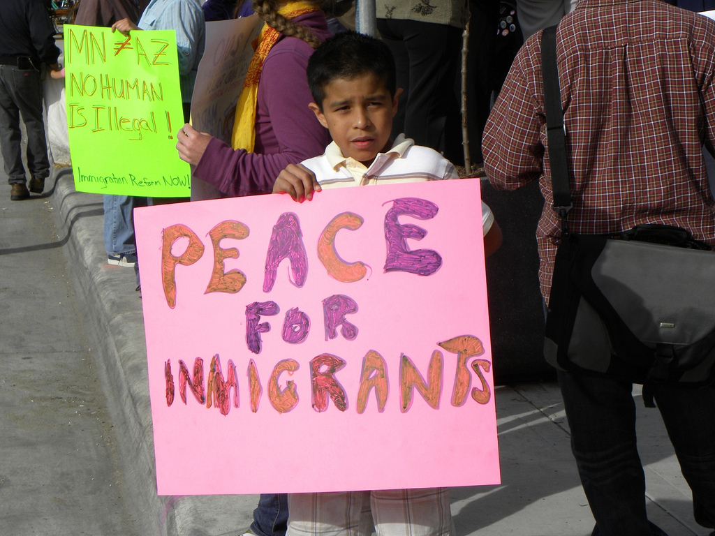 Protesting Arizona's immigrant law, this young boy and many  other citizens in the U.S. want to see peace for immigrants. After separating hundreds of families, President Trump has left their fate in the hands of the Justice Department.