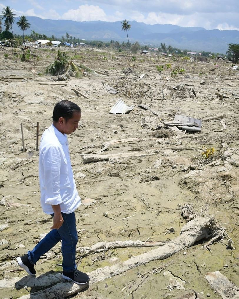 The President of Indonesia, Joko Widodo, walks around the city of Palu. The previously lively city has been demolished to sandy earth by the 7.5 magnitude earthquake and 18-foot tsunami that slammed the area on September 28, 2018.