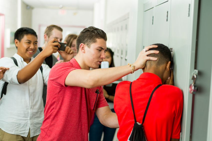 Shoving a kid's head into a locker, this bully makes fun of someone he knows will not fight back. Bullies prey on timid individuals who will not fight back. However, by being a bystander, you are able to help someone in need by letting an authority figure know.