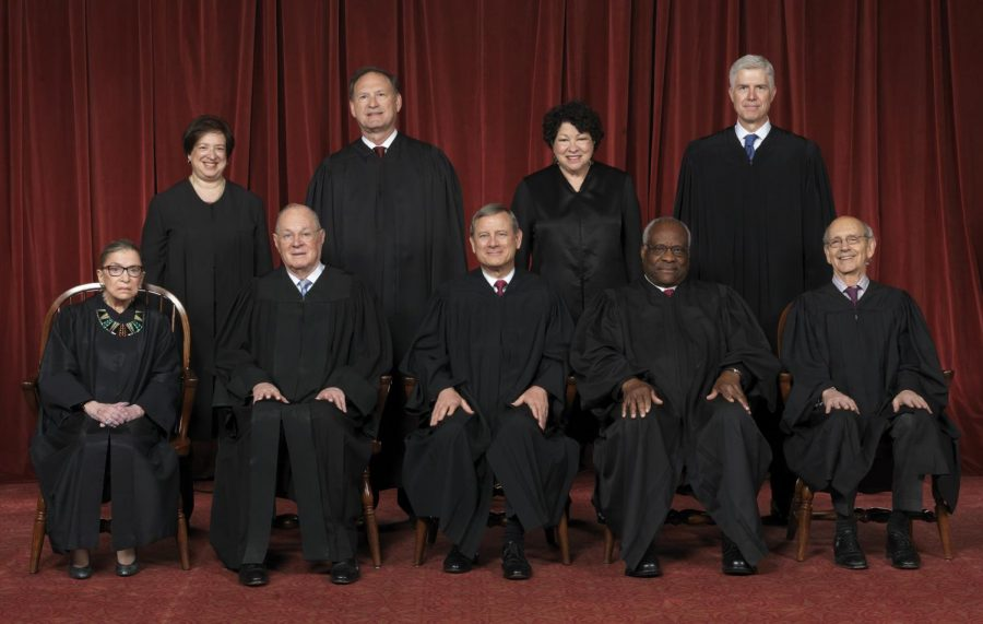 Smiling for the official Supreme Court photo, Neil Gorsuch is introduced as an Associate Justice with his fellow court members. After every new nominee is confirmed, an updated official portrait of the Supreme Court is taken.