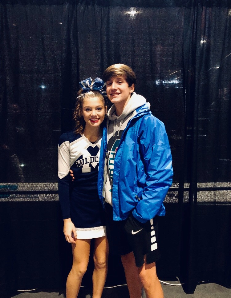 "Despite cheer and other extracurriculars, Josie Mosler and Collin Sykes find time for each other, all while balancing schoolwork. They have earned the ""cute couple"" status and are determined to cherish the three years they have left together at Millbrook!"