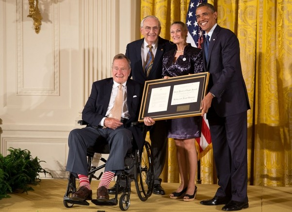 Bestowing the 5,000th Daily Point of Light Award together, former presidents George H.W. Bush and Barack Obama demonstrate  unity. Bush passed away November 30 and was put to rest December 5.