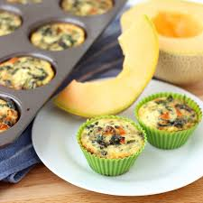 """Cooling from coming out of the oven, these egg muffins show an array of colors from the different ingredients cooked inside. """"Eating the rainbow"""" puts you in a mindset to eat a variety of foods so you can get a wide range of nutrients which is important when starting your day."""