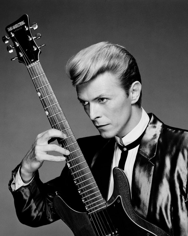 Sporting+one+of+his+famous+poses%2C+Bowie+will+forever+be+known+for+his+iconic+gestures+and+stances+he+used+for+his+album+covers.+Bowie+was+a+revolutionary+member+of+the+glamor+rock+genre+and+even+rose+to+great+fame+because+of+his+overzealous+nature.